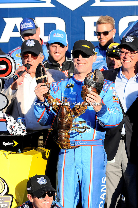 Sunday, September 25, 2016: Sprint Cup Series driver Kevin Harvick (4) poses with Loudon the lobster after winning the NASCAR Sprint Cup Series Bad Boy Off Road 300 race held at the New Hampshire Motor Speedway in Loudon, New Hampshire. Eric Canha/CSM