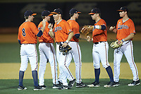 The Virginia Cavaliers celebrate following their win over the Wake Forest Demon Deacons at David F. Couch Ballpark on May 18, 2018 in  Winston-Salem, North Carolina.  The Cavaliers defeated the Demon Deacons 15-3.  (Brian Westerholt/Four Seam Images)
