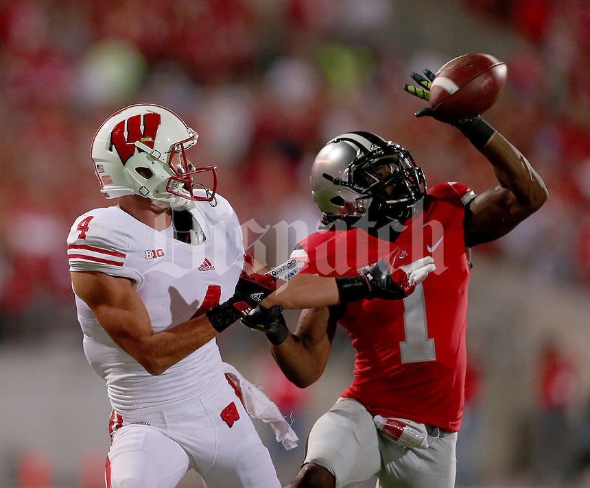 Wisconsin Badgers wide receiver Jared Abbrederis (4) prepares to catch a touchdown pass against Ohio State Buckeyes cornerback Bradley Roby (1) during the first half of the game between Ohio State and Wisconsin at Ohio Stadium on Saturday, September 28, 2013. (Columbus Dispatch photo by Jonathan Quilter)