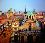 View over rooftops with church towers and domes, Prague, Czech Republic