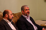 """Hamas chief Khaled Meshaal meets with Palestinian president Mahmud Abbas and other top Fatah officials in Cairo on November 24, 2011. Abbas and Meshaal hailed a new Palestinian """"partnership"""" after talks to implement a landmark reconciliation deal. Photo by Ashraf Amra"""