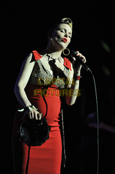 Imelda May .performing live in concert at the Royal Albert Hall, London, England, UK, .4th May 2012..music gig on stage half length pregnant red  dress leopard print microphone quiff singing tambourine.CAP/MAR.© Martin Harris/Capital Pictures.