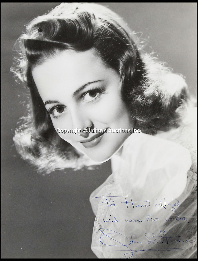 BNPS.co.uk (01202 558833)<br /> Pic: JuliensAuctions/BNPS<br /> <br /> Gone With The Wind's Olivia de Havilland. <br /> <br /> The Rogues Gallery - Unique Who's who from the halcyon days of Hollywood, collected by one of their own, comedian Harold Lloyd.<br /> <br /> The silent movie actor asked his silver screen chums to send him their best loved publicity shots one Xmas, so he could create a 'Rogues Gallery' at his Hollywood mansion.<br /> <br /> The unique collection reveals tinsel town as it preferred to see itself in its most glamourous era between the wars.