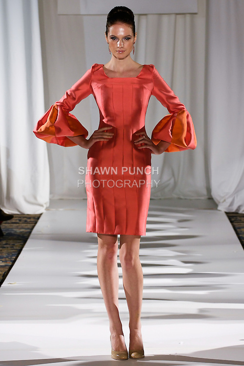 Tania walks runway in a coral silk-faced wool, ornament sleeve sheath, from the b Michael AMERICA Couture Spring 2013 collection during Mercedes-Benz Fashion Week Spring 2013, at the Jumeirah Essex House on September 12, 2012.