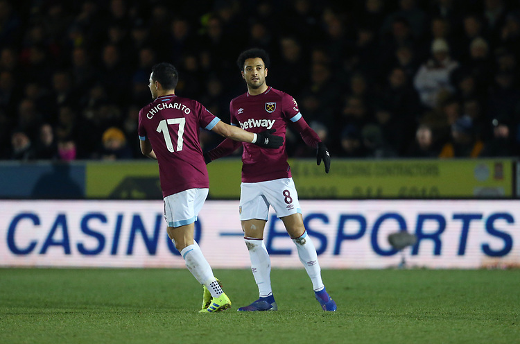 West Ham United's Felipe Anderson celebrates scoring his side's second goal with Javier Hernandez<br /> <br /> Photographer Rob Newell/CameraSport<br /> <br /> Emirates FA Cup Fourth Round - AFC Wimbledon v West Ham United - Saturday 26th January 2019 - Kingsmeadow Stadium - London<br />  <br /> World Copyright © 2019 CameraSport. All rights reserved. 43 Linden Ave. Countesthorpe. Leicester. England. LE8 5PG - Tel: +44 (0) 116 277 4147 - admin@camerasport.com - www.camerasport.com