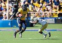 September 4, 2010:  Jeremy Ross of California avoids a tackle by Damien Thigpen of UCLA during a game at Memorial Stadium in Berkeley, California.   California defeated UCLA 35-7