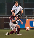Stenny's Brown Ferguson challenges Queen of the South's Kevin Holt.