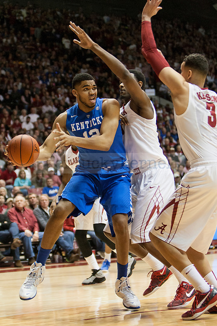 Center Karl-Anthony Towns of the Kentucky Wildcats passes the ball during the game against the Alabama Crimson Tide at Coleman Coliseum on Saturday, January 17, 2015 in in Tuscaloosa, AL. Kentucky defeated Alabama 70-48. Photo by Michael Reaves | Staff