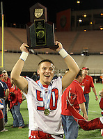 Manatee Hurricanes linebacker Alex Bernhardt #50 hoists the Championship trophy after the Florida High School Athletic Association 7A Championship Game at Florida's Citrus Bowl on December 16, 2011 in Orlando, Florida.  Manatee defeated First Coast 40-0.  (Mike Janes/Four Seam Images)