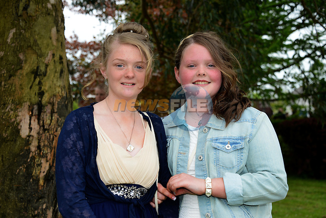 Katie O'Connor and Leah Finglas pictured after their confirmation at Holy Family Church, Ballsgrove on Saturday. Photo: Andy Spearman. www.newsfile.ie