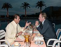 ARCHIVE: MONACO:  JUNE 1988: Roger Moore & Michael Caine at celebrity tennis tournament in Monaco.<br /> File photo © Paul Smith/Featureflash