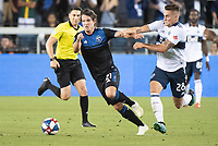 SAN JOSE, CA - AUGUST 25: Carlos Fierro #21 of the San Jose Earthquakes evades Jake Nerwinski #28 of the Vancouver Whitecaps during a game between Vancouver Whitecaps FC and San Jose Earthquakes at Avaya Stadium on August 24, 2019 in San Jose, California.