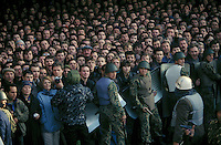 Moscow, Russia, 04/10/1993..Pro-Government soldiers hold back cheering crowds watching the assault on the Russian Parliament. When President Boris Yeltsin dissolved the opposition-dominated Russian Parliament,  deputies and supporters, led by Vice President Alexander Rutskoi, barricaded themselves inside the White House. After a 10 day stand-off the situation exploded into violence between pro and anti Yeltsin forces.