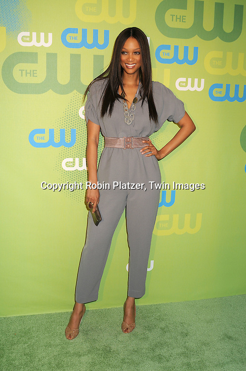 Tyra Banks in vintage jumpsuit