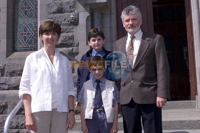 Donal Martin with his brother Cian and parents Gerard and Rosaleen at First communion in Tullyallen Church.Picture Fran Caffrey Newsfile