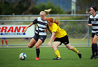 Action from the New Zealand Age Group Championships Under-16 Girls match between Northern (white and black stripes) and Capital at Memorial Park in Petone, Wellington, New Zealand on Wednesday, 13 December 2017. Photo: Dave Lintott / lintottphoto.co.nz