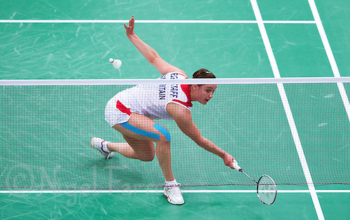 28 JUL 2012 - LONDON, GBR - Susan Egelstaff (GBR) of Great Britain returns during her London 2012 Olympic Games women's singles group badminton match against Maja Tvrdy (SLO) of Slovenia at Wembley Arena, London, Great Britain .(PHOTO (C) 2012 NIGEL FARROW)