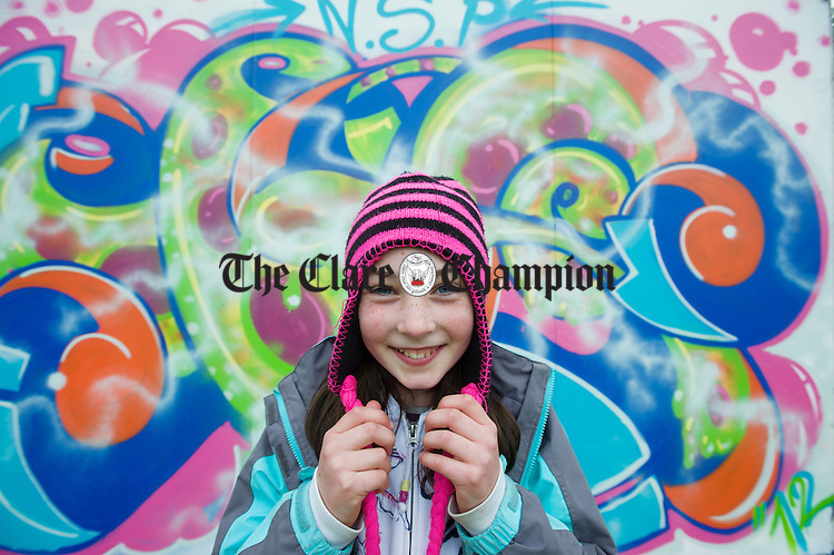 Dublin's Roisin Connolly (10) blending her colours to a graffiti wall which was painted as part of the Iniscealtra Festival of Arts at Mountshannon. Photograph by John Kelly.