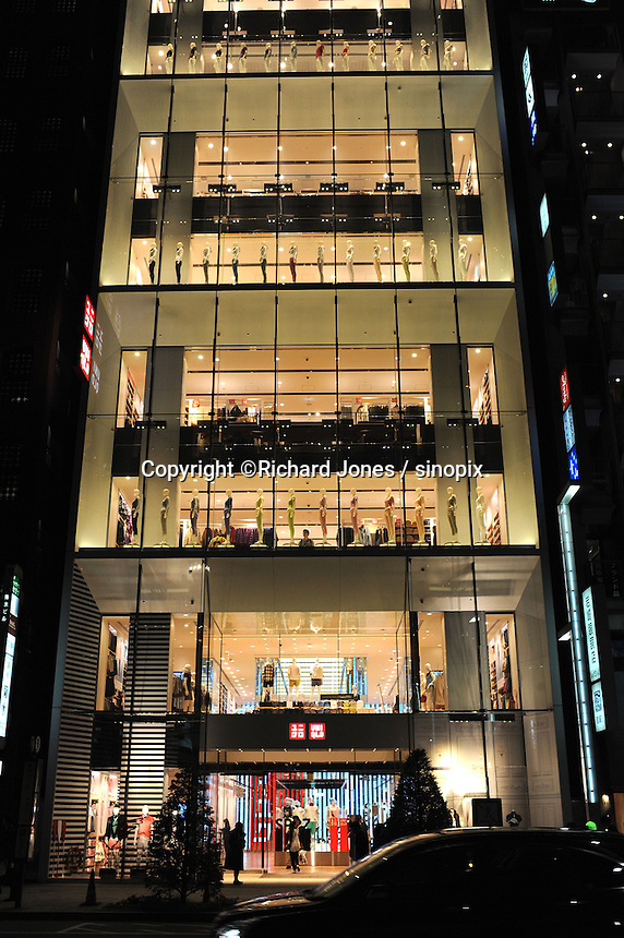 Japanese retailer Uniqlo's Ginza store, Ginza, Tokyo Japan. The retailer sells popular affordable everyday clothes. <br /> April-2014