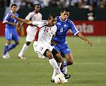 7 June 2007: Trinidad's Darryl Roberts (14) dribbles away from El Salvador's Carlos Menjivar (8). The National Team of El Salvador defeated the National Team of Trinidad & Tobago 2-1 at the Home Depot Center in Carson, California in a first round game in the CONCACAF Gold Cup.