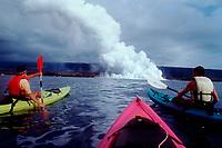 sea kayaking near point where lava flows into the Pacific Ocean, Kilauea Volcano, Hawaii, USA Volcanoes National Park, Big Island, Hawaii, USA