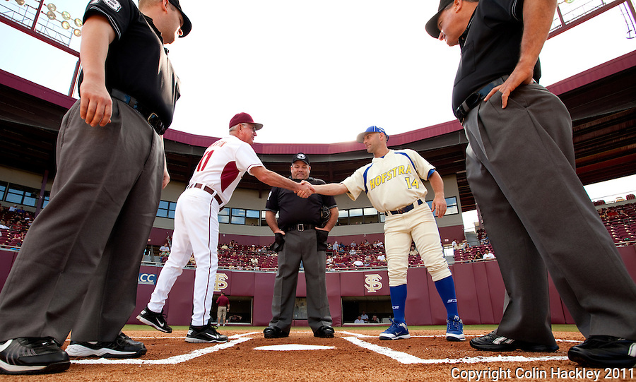 TALLAHASSEE, FL 2/26/11-FSU-HOFSTRA BASE11 CH-Florida State Head Coach Mike Martin, left, shakes hands with Hofstra Head Coach Patrick Anderson at the start of the game Saturday at Dick Howser Stadium in Tallahassee. The Seminoles beat the Pride 16-3...COLIN HACKLEY PHOTO