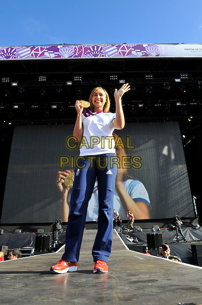 Jessica Ennis .Gold Medal Winner for Team GB, attending BT London Live, Hyde Park, London, England. .5th August 2012.heptathlon  track and field athlete  full length white t-shirt blue tracksuit medal track and field athlete smiling hand arm waving  .CAP/MAR.© Martin Harris/Capital Pictures.