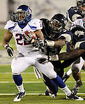 Nevada Wolf Pack linebacker Brandon Marshall grabs Boise State Broncos running back Doug Martin's face mask during the NCAA college football game Saturday night, Nov. 26, 2010, in Reno, Nev. (AP Photo/Cathleen Allison)..