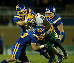 BROOKINGS, SD - OCTOBER 3:  King Frazier #22 from North Dakota State is wrapped up by a Nick Mears #42 and Jimmy Forsythe #25 from South Dakota State in the second half of their game Saturday night at Coughlin Alumni Stadium in Brookings.(Photo by Dave Eggen/Inertia)