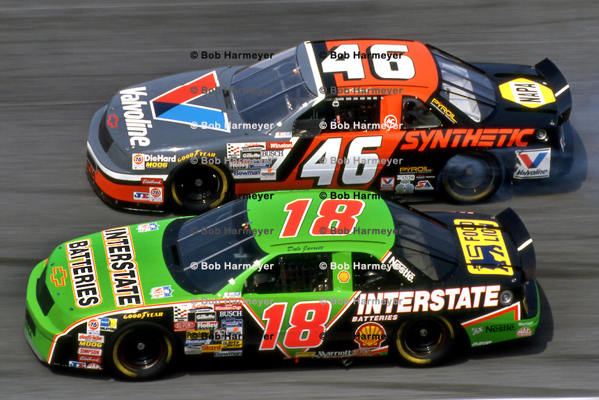 DAYTONA BEACH, FL - FEBRUARY 14: Dale Jarrett drives his Interstate Batteries Chevrolet Lumina below the smoking Valvoline Chevrolet Lumina of Al Unser, Jr., during practice for the Daytona 500 NASCAR Winston Cup race at the Daytona International Speedway in Daytona Beach, Florida, on February 14, 1993.
