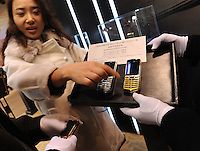Buyers at the Hangzhou International Luxury Exhibition look at Saphire REYN, a phone limited edition luxury mobile phone, targeted at high-end business people in Hangzhou, China 24 Jan 2010.<br /> <br /> PHOTOS BY SINOPIX