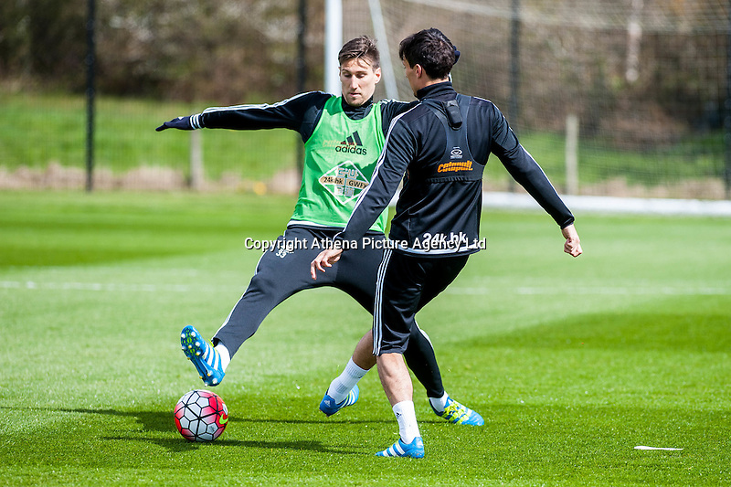 Wednesday  27 April 2016<br /> Pictured: Federico Fernandez of Swansea City  and Jack Cork in action during training <br /> Re: Swansea City Training Session at the Fairwood Ground, Swansea, Wales, UK