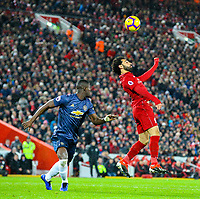 Liverpool's Mohamed Salah wins a header under pressure from Manchester United's Eric Bailly<br /> <br /> Photographer AlexDodd/CameraSport<br /> <br /> The Premier League - Liverpool v Manchester United - Sunday 16th December 2018 - Anfield - Liverpool<br /> <br /> World Copyright © 2018 CameraSport. All rights reserved. 43 Linden Ave. Countesthorpe. Leicester. England. LE8 5PG - Tel: +44 (0) 116 277 4147 - admin@camerasport.com - www.camerasport.com