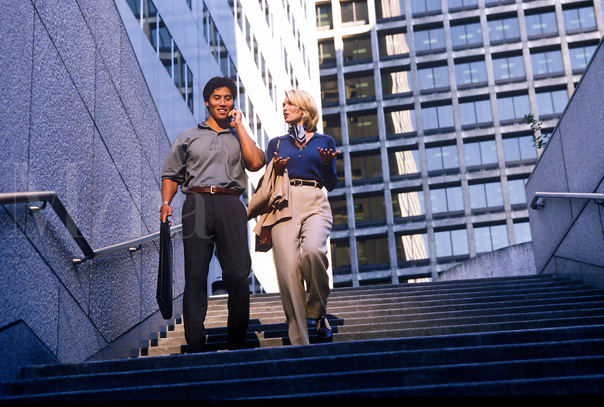 Man and woman in casual dress conducting business.