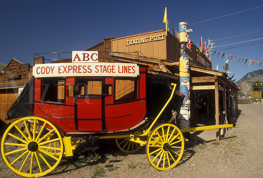 AJ3558, stage coach, Cody, Wyoming, A red stage coach of ABC Cody Express Stage Lines is parked in front of an old trading post in Cody in the state of Wyoming.