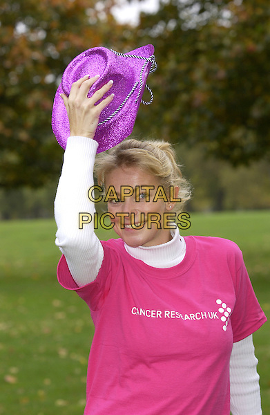 "TERRI DWYER.starting  Cancer Research UK's ""Stride for Life"" a 10 km sponsored walk during Breast Cancer Awareness Month..Hyde Park, London. Sunday 22 October 2004..Ref: PL.half length, purple cowboy hat, pink t shirt, t-shirt, gesture.www.capitalpictures.com.sales@capitalpictures.com.©Capital Pictures"