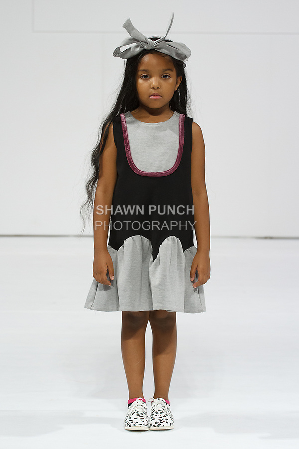Model walks runway in an outfit from the Amour Bows collection, for the petitePARADE Spring Summer 2018 fashion show with Children's Club, at Javits Center in New York City, on August 7, 2017.