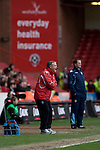 Sheffield United 2 Leeds United 0, 19/03/2011. Bramall Lane, Championship. Sheffield United manager Micky Adams (left) and his opposite number Simon Grayson watching the action during the first half of the Npower Championship fixture with Leeds United. The home team won the game by two goals to nil watched by a crowd of 23,728. Bramall Lane is the world's oldest professional football ground and at one time hosted both football and cricket. Photo by Colin McPherson.