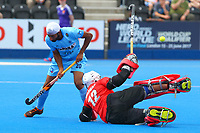 Malaysian goalkeeper Mazhar Abbas blocks a shot during the Hockey World League Semi-Final 5-8th place match between Pakistan and India at the Olympic Park, London, England on 24 June 2017. Photo by Steve McCarthy.