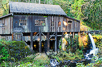The Cedar Creek Grist Mill in Woodland, WA rests on a steep and rocky slope at the bottom of a narrow gorge. It is the only grain grinding mill in the State of Washington that has maintained its original structural integrity, grinds with stones and is water powered.<br /> George Woodham and his two sons built the water powered mill in 1876.