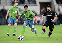 LOS ANGELES, CA - OCTOBER 29: Xavier Arreaga #25 of the Seattle Sounders FC moves with the ball past Lee Nguyen #24 of Los Angeles FC during a game between Seattle Sounders FC and Los Angeles FC at Banc of California Stadium on October 29, 2019 in Los Angeles, California.