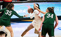 COLLEGE PARK, MD - DECEMBER 8: Kaila Charles #5 of Maryland holds the ball back from Ava Therien #35 of Loyola during a game between Loyola University and University of Maryland at Xfinity Center on December 8, 2019 in College Park, Maryland.