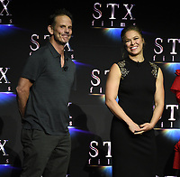 LAS VEGAS, NV - APRIL 24: Director Peter Berg and Ronda Rousey onstage during the STX Films presentation at CinemaCon 2018 at The Colosseum at Caesars Palace on April 24, 2018 in Las Vegas, Nevada. (Photo by Frank Micelotta/PictureGroup)