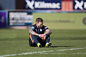 17th March 2019, Dens Park, Dundee, Scotland; Ladbrokes Premiership football, Dundee versus Celtic; Martin Woods of Dundee dejected at the end of match as Celtic scored  in the 96th minute