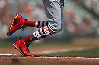 SAN FRANCISCO, CA - SEPTEMBER 2:  Detail of Dexter Fowler #28 of the St. Louis Cardinals running to first base while wearing Nike cleats and striped socks during the game against the San Francisco Giants at AT&T Park on Saturday, September 2, 2017 in San Francisco, California. (Photo by Brad Mangin)