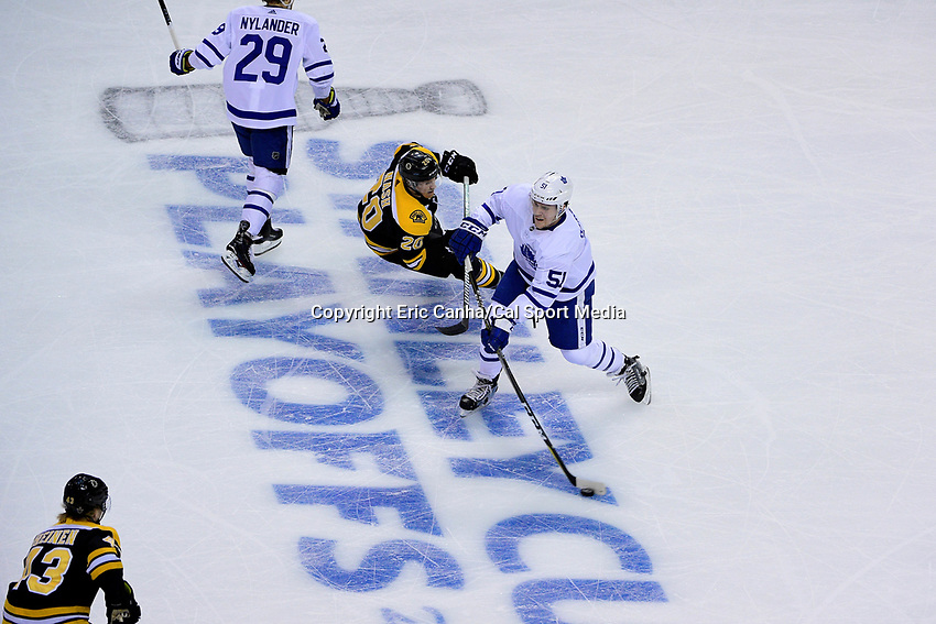April 21, 2018: Toronto Maple Leafs defenseman Jake Gardiner (51) passes the puck during game five of the first round of the National Hockey League's Eastern Conference Stanley Cup playoffs between the Toronto Maple Leafs and the Boston Bruins held at TD Garden, in Boston, Mass. Toronto defeats Boston 4-3, Boston leads Toronto 3 games to 2 in the best of 7 series.