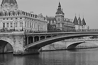 Black and White landscape of Seine River, Paris.  Shot of the river with the Pont de Notre Dame and the Pont au Change.  The Cour d'Appel de Paris (Appellate Court) and the Orangerie.