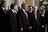 United States President Donald J. Trump talks to the press after the Republican Policy luncheon at the U.S. Capitol Building on January 9, 2019 in Washington, DC. Pictured from left to right: US Senator John Thune (Republican of South Dakota), US Senator John Barrasso (Republican of Wyoming), US Vice President Mike Pence, the President, US Senator Todd Young (Republican of Indiana), US Senate Majority Leader Mitch McConnell (Republican of Kentucky), and US Senator Joni Ernst (Republican of Iowa).<br /> Credit: Olivier Douliery / Pool via CNP