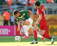 Guillermo Franco of Mexico puts his head down and speeds away from Andranik Teymourian of Iran. Mexico defeated Iran 3-1 during a World Cup Group D match at Franken-Stadion, Nurenberg, Germany on Sunday June 11, 2006.