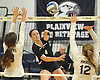Massapequa No. 4 Jamie Smith makes a spike attempt during a Nassau County varsity girls' volleyball match against host Plainview JFK High School on Monday, October 19, 2015. Massapequa won 25-16, 25-8, 25-13.<br /> <br /> James Escher